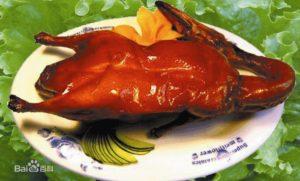 Anatra alla pechinese, specialità della cucina cinese settentrionale.